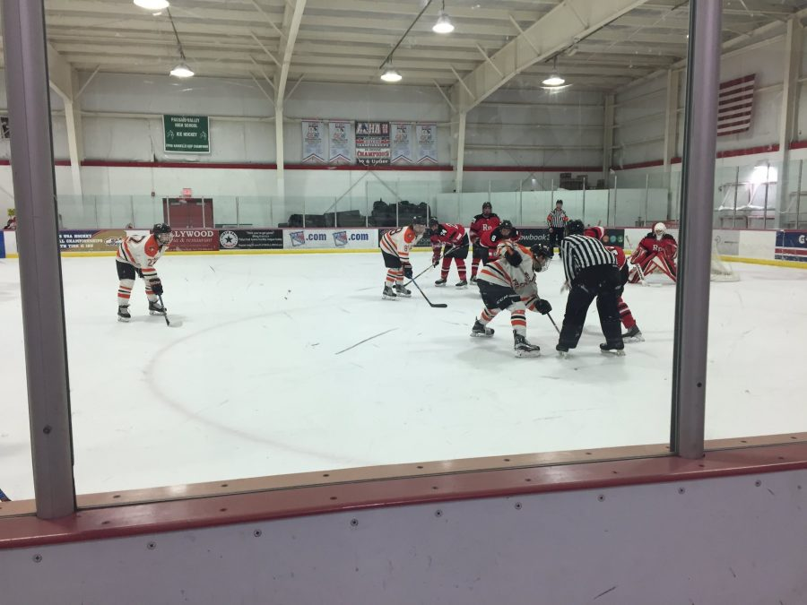Courtesy of @wpuhockey Twitter. RPI and WPU get ready to take the faceoff in RPI's defensive zone.