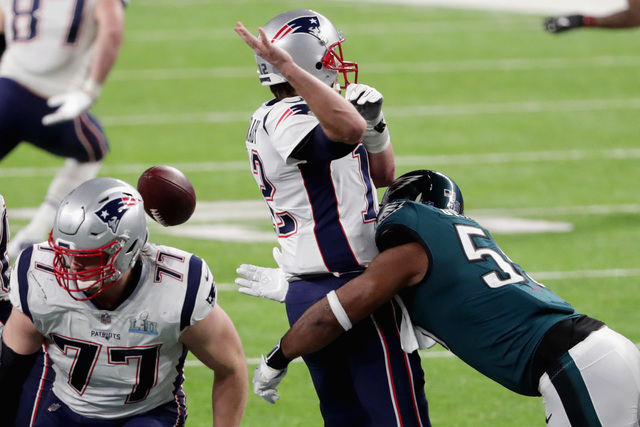 Tom+Brady+%28%2312%29+has+the+ball+stripped+by+Brandon+Graham+%28%2355%29+of+the+Philadelphia+Eagles+late+in+the+fourth+quarter+in+Super+Bowl+LII%2C+symbolizing+the+Patriots+losing+handle+on+their+latest+dynasty+run.+%28Via+Photo+by+Streeter+Lecka%2FGetty+Images%29