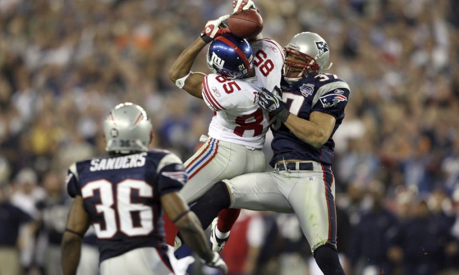 The+infamous+helmet+catch+made+by+New+York+Giants+wide+receiver%2C+David+Tyree+%2885%29+over+New+England+Patriots+defender%2C+Rodney+Harrison+%2837%29+that+lead+to+the+game+winning+drive+by+New+York+in+in+Super+Bowl+XLII%2C+spoiling+New+England%27s+chance+at+a+perfect+season+at+19-0.++This+was+the+first+Super+Bowl+in+which+Big+Blue+proved+to+be+Tom+Brady+and+co.+kryptonite%2C+as+the+two+met+again+just+four+years+later+in+Super+Bowl+XLVI.+%28Photo+by+Andy+Lyons%2FGetty+Images%29