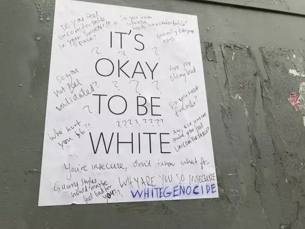 www.blazingcatfur.ca// People fight back, writing messages of inclusion on a racist flyer at an unspecified location.
