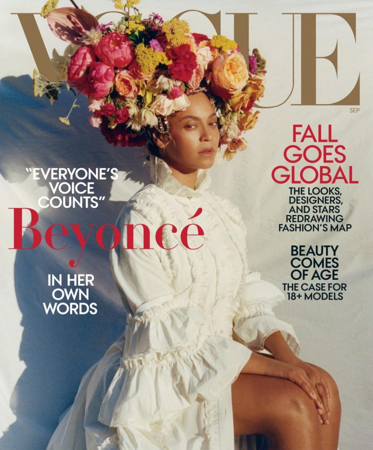 Beyonce on Vogue's September 2018 cover.  Credit: Photographed by Tyler Mitchell, Vogue. Gucci dress. Lynn Ban headpiece. Floral headdress by Rebel Rebel.
